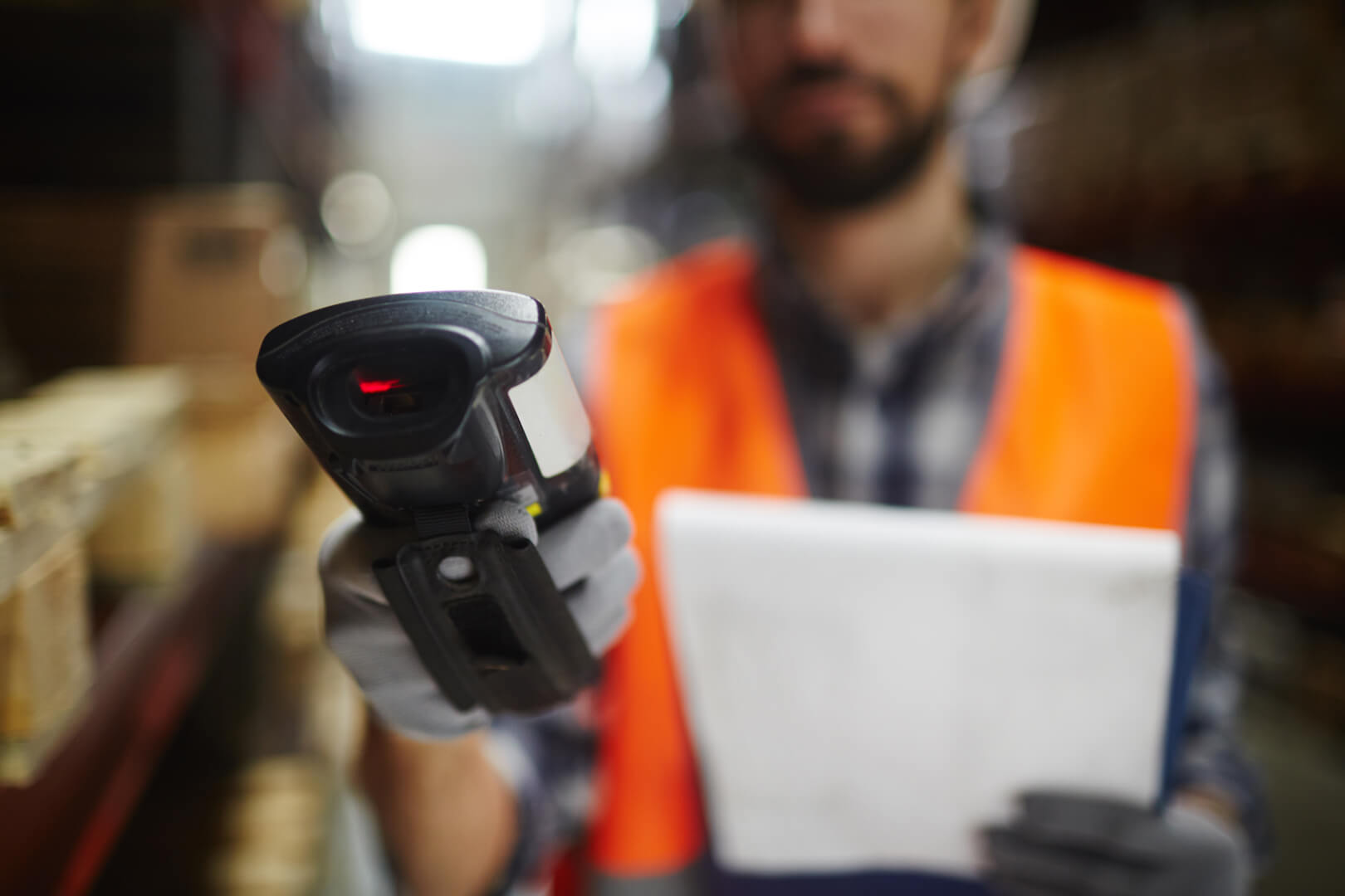 Worker with hand-held barcode scanner